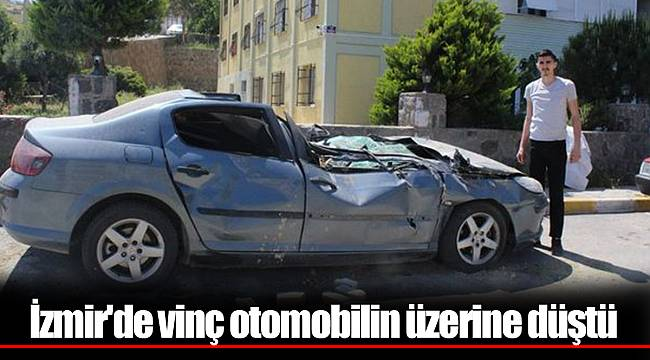İzmir'de vinç otomobilin üzerine düştü