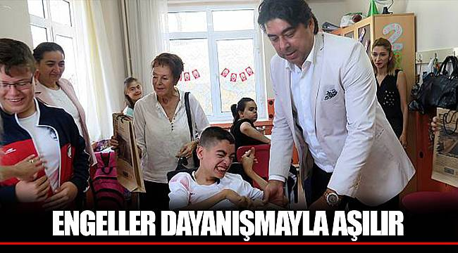 ENGELLER DAYANIŞMAYLA AŞILIR