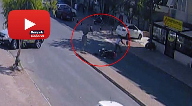 Kafası otomobilin altında kaldı, kaskı sayesinde kurtuldu