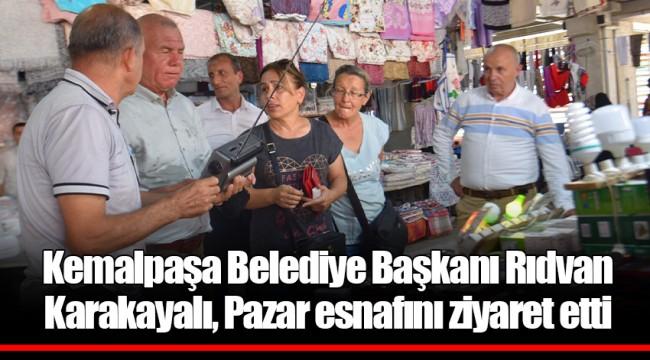 Kemalpaşa Belediye Başkanı Rıdvan Karakayalı, Pazar esnafını ziyaret etti
