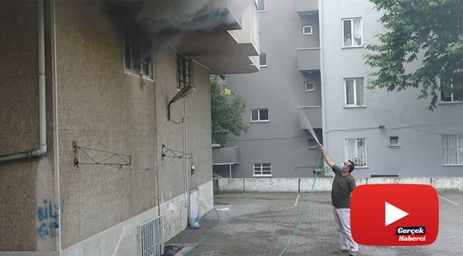 İş yerinde çıkan yangını bahçe hortumu ile söndürmeye çalıştı