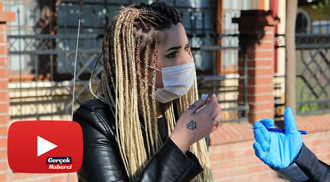 Maske takmayan kadın, polisleri tehdit edip gazetecilere tepki gösterdi